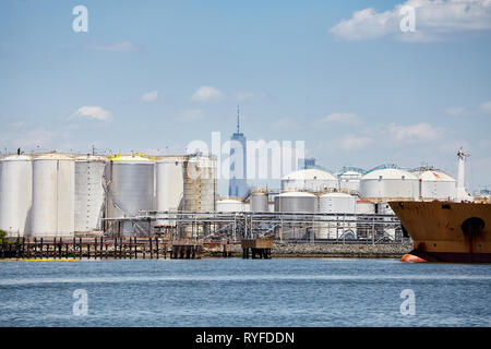 Industrial zone with New York skyscraper in distance, USA. - Stock Image