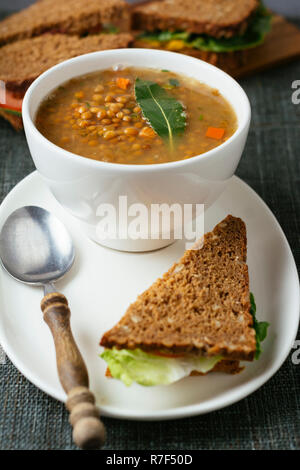 Lentil soup with sandwiches. - Stock Image