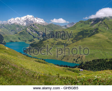 Roselend lake and the Mont-Blanc mountain near Beaufort in Savoie (France) - Stock Image