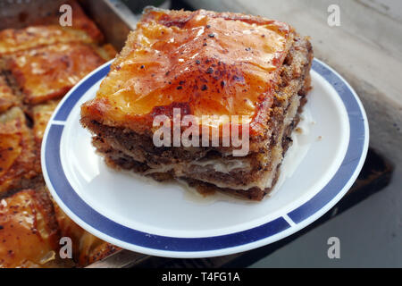 Home made food. Baked baklava. A traditional dessert with sugar syrup. Prepares for Christmas. - Stock Image