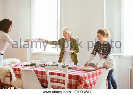Women preparing for family Christmas party - Stock Image