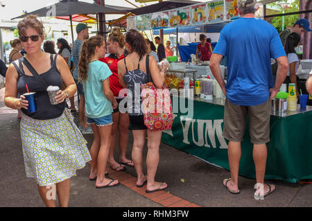 People enjoying the Nightcliff Market in Darwin, Australia. - Stock Image
