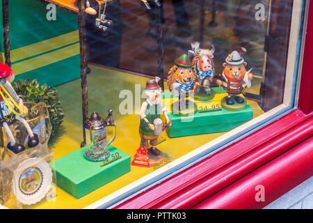 Tourist souvenirs in the form of animals dressed as tradesmen, Bruges, (Brugge), Belgium - Stock Image