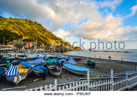 Early morning at a small harbor in the Italian village of Monterosso Al Mare, on the Ligurian coast at Cinque Terre Italy with boats on a sandy beach - Stock Image