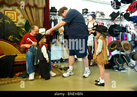 Tourist family getting ready in western style clothing at Wildwest for photo Shoot in Galveston, USA - Stock Image
