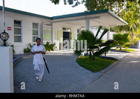 Asia Hospital - a nurse outside the local hospital, Rasdhoo island, Rasdhoo atoll. - Stock Image