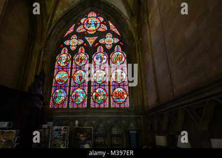 Beautiful stained glass window on the interior of Our Lady of Bayeux Cathedral in Bayeux France. - Stock Image