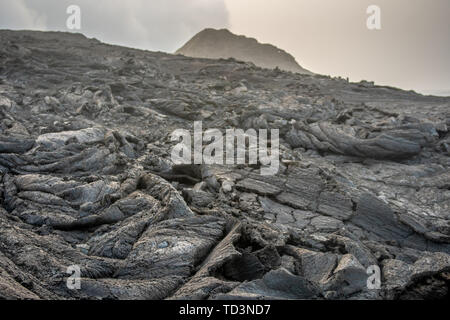 A dirt road leading to Erta Ale Volcano, a continuously active basaltic shield volcano and lava lake in the Afar Region of Ethiopia - Stock Image