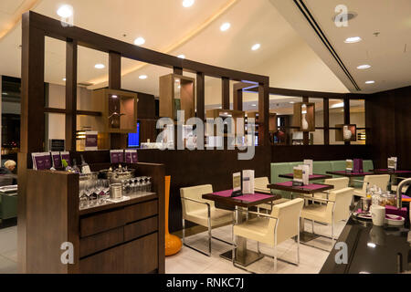 UK, England, Manchester, Airport, the airport owned 1903 lounge, used by Etihad Business Class passengers, dining area tables - Stock Image