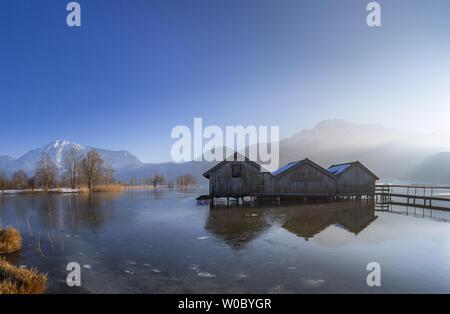 Boathouses on the Kochelsee, Bavaria, Germany - Stock Image