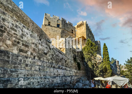 The medieval castle, the Governor's Palace of the Castle of the Knights of St John, in the ancient Greek town of Lindos on the island of Rhodes, Greec - Stock Image