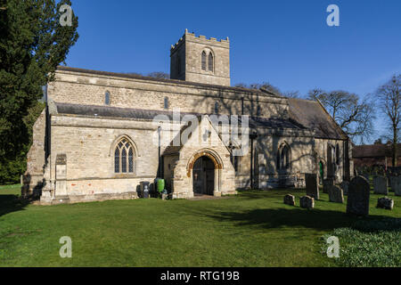 The church of St John the Baptist in the village of Chelveston, Northamptonshire, UK; earliest parts date from 13th century but restored in 1849. - Stock Image