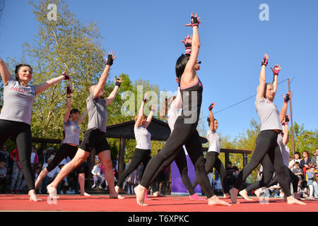 Nis, Serbia - April 20, 2019 Group of people practicing Piloxing sport in an outdoor class in summer with teacher - Stock Image