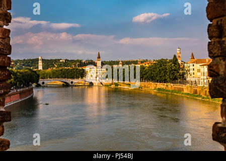 River Adige and church towers at dusk in Verona, Italy - Stock Image