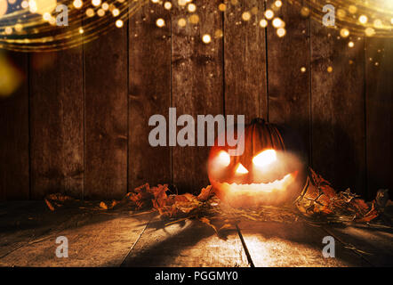 Spooky halloween pumpkin on wooden planks in dark cellar. Celebration theme, copyspace for text. Very high resolution image - Stock Image