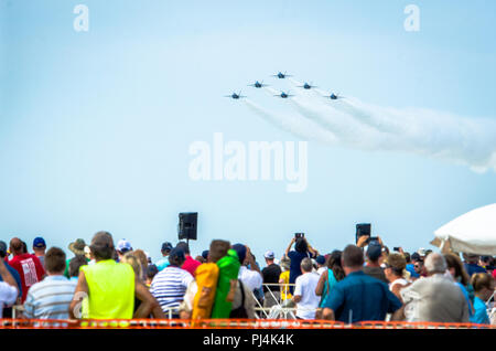 Attendees of the Sound of Speed Air Show and Open House watch a performance from the Navy Flight Demonstration Squadron, the Blue Angels, during the Sound of Speed Air Show and Open House at Rosecrans Air National Guard Base, St. Joseph, August 26, 2018. The air show was hosted by the 139th Airlift Wing, Missouri Air National Guard and city of St. Joseph to thank the community for their support. The air show committee estimated around 70,000 people attended the weekend performances. The Blue Angels strive to showcase the pride and professionalism of the United States Navy and Marine Corps by i - Stock Image