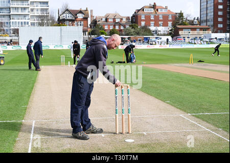 Hove Sussex, UK. 05th Apr, 2019. One of the Sussex groundsmen Marc Gravett prepares the stumps on his last day working at the club before the Specasavers County Championship Division Two match between Sussex and Leicestershire at the 1st Central County Ground in Hove on a sunny but cool first morning of the season Credit: Simon Dack/Alamy Live News - Stock Image