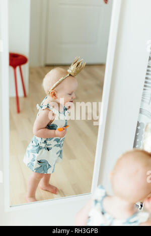 Girl in mirror - Stock Image
