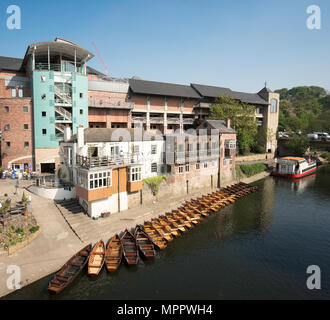 Durham Boat Club bar with a row of rowing boats moored in the river Wear, Elvet Riverside, Durham, England, UK - Stock Image