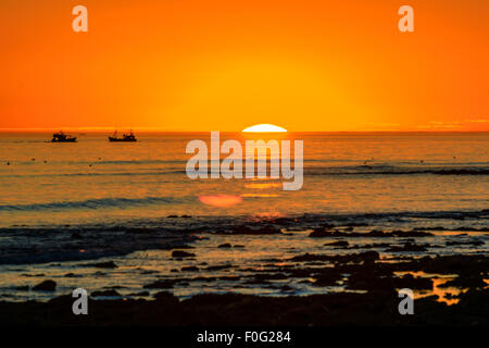 Sunset with fishing boats in La cotiniere, France - Stock Image