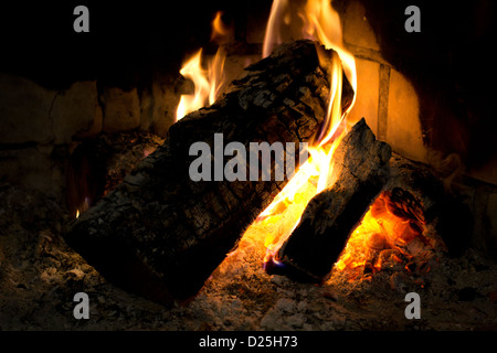 A warm and confortable fireplace. - Stock Image