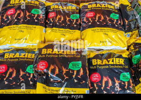 Stack of bags of Brazier Multi Purpose  Smokeless fuel for sale in a garden centre - Stock Image