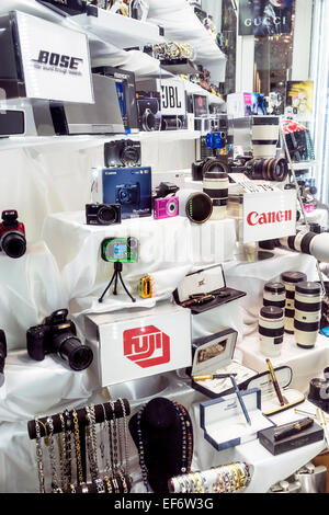 Camera and electronics shop window along Lincoln Road Mall on Miami Beach features Bose, JBL, Canon, Fuji and Gucci - Stock Image