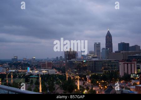 aerial Atlanta buildings centennial city clouds downtown dusk glow lights Olympic overcast park skyline storm urban - Stock Image