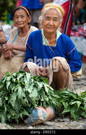 Hanunoo Mangyan women selling their crops at a Mangyan market near Mansalay, Oriental Mindoro, Philippines. - Stock Image