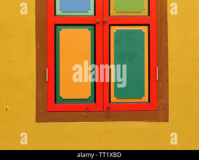 Bright coloured shapes on houses in Singapore. - Stock Image