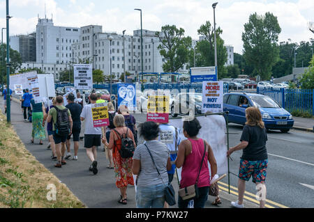 London, UK. 7th July 2018. Keep Our St Helier Hospital (KOSHH) campaigners against the closure of acute facilities at Epsom and St Helier Hospitals in south London celebrating the 70th Birthday of the NHS with a march from Sutton arrive at St Helier Hospital for a rally.   he of so Credit: Peter Marshall/Alamy Live News - Stock Image