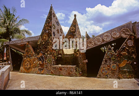 Malasian pottery village showing ceramic tiling on the toilet building.All broken shards of pottery are used in tiling the buildings. - Stock Image