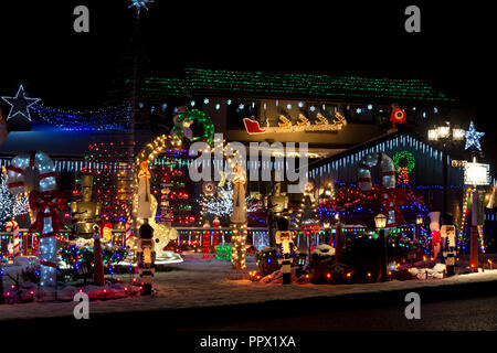 Festive outdoor holiday Christmas lights at a home in Metro Vancouver, BC, Canada,  at night. - Stock Image