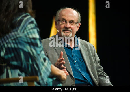 Salman Rushdie in conversation with Tishani Doshi on stage in the Tata Tent at Hay Festival 2018 Hay-on-Wye Powys Wales UK - Stock Image