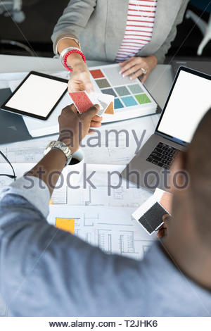 Interior designers looking at swatches - Stock Image