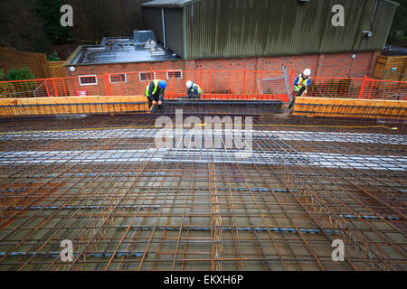 Concrete reinforcing bars laid on roof prior to pouring. - Stock Image