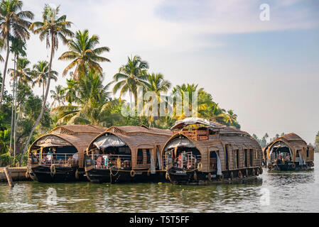 Horizontal view of traditional riceboats moored in Kerala, India. - Stock Image