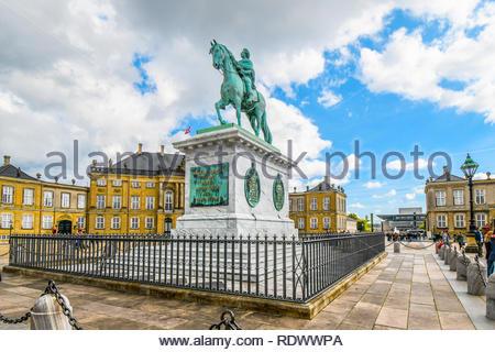 Sculpture of Frederik V on Horseback in Amalienborg Square in Copenhagen, Denmark with the Copenhagen Opera House in the distance. - Stock Image