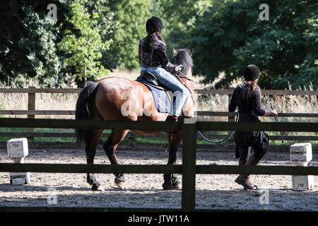 London, UK. 10th August, 2017. A young horse rider makes the most of the sunny weather in Hyde Park, London, UK. Credit: Ben Furst/Alamy Live News. - Stock Image