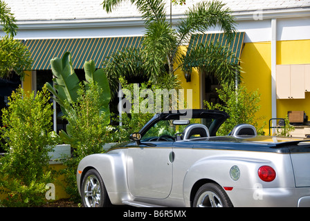 Silver Convertible car auto top down 3rd st s Third Street South Naples Florida Fl chic shopping area - Stock Image