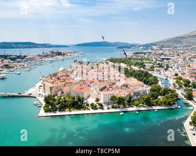 Aerial view of touristic old Trogir, historic town on a small island and harbour on the Adriatic coast in Split-Dalmatia County, Croatia. Flock of gul - Stock Image