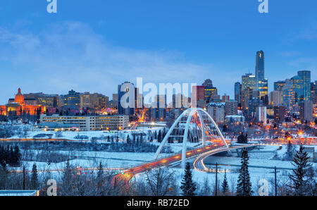 Edmonton downtown Winter skyline just after sunset showing Alberta Legislature and Walterdale Bridge across the frozen, snow-covered Saskatchewan Rive - Stock Image