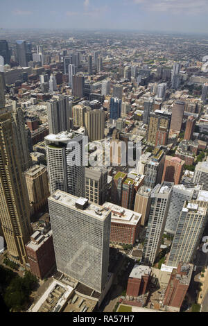 Downtown Chicago skyscrapers in aerial view of towards horizon - Stock Image