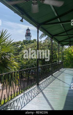 Ernest Hemingway's House in Key West, Florida, USA. In the distance is the Key West lighthouse. - Stock Image