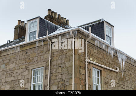 Icicles hang from guttering of a Georgian house in Kelso, Scotland, during March 2018 when freezing temperatures hit the country - Stock Image