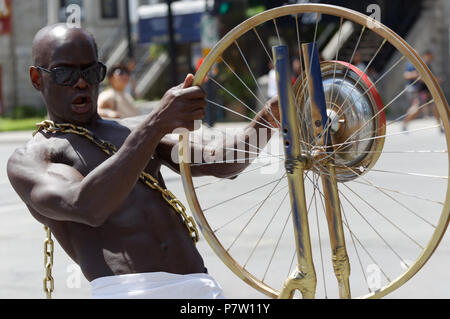 Montreal, Canada. 7/7/2018. A man participates in the  Carifiesta parade in downtown Montreal. Credit: richard prudhomme/Alamy Live News - Stock Image
