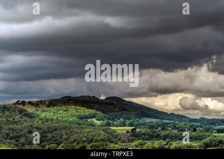 South Downs, UK. 11th June, 2019. Changeable weather conditions on the South Downs near Lewes today Credit: Andrew Hasson/Alamy Live News - Stock Image