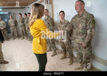 U.S. First Lady Melania Trump greets U.S. service members during a surprise visit to Al Asad Air Base December 26, 2018 in Al Anbar, Iraq. The president and the first lady spent about three hours on Boxing Day at Al Asad, located in western Iraq, their first trip to visit troops overseas since taking office. - Stock Image