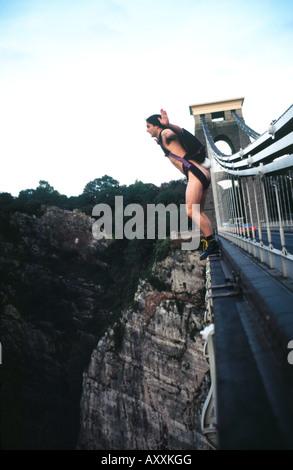 UK Naked BASE 1 BASE Jumping naked off Clifton Suspension Bridge Avon Gorge Great Britain - Stock Image