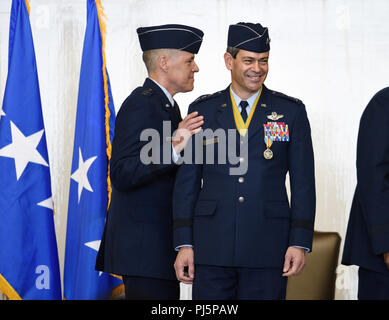 U.S. Air Force Lt. Gen. Thomas A. Bussiere and Lt. Gen. Kenneth S. Wilsbach participate in a change of command ceremony for the Alaskan NORAD Region, Alaskan Command and Eleventh Air Force at a change of command ceremony at Joint Base Elmendorf-Richardson, Alaska 24 Aug., 2018. Bussiere is a 1985 distinguished graduate of Air Force Reserve Officer Training Corps and has held a variety of flying, staff and command assignments. Bussiere was the Commander, Eighth Air Force, and Commander, Joint-Global Strike Operations Center, Barksdale Air Force Base, Louisiana prior to taking his current comman - Stock Image